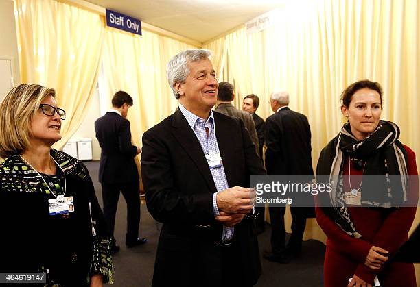 James 'Jamie' Dimon chief executive officer of JPMorgan Chase Co center reacts as he talks with delegates during a break in sessions on day two of...