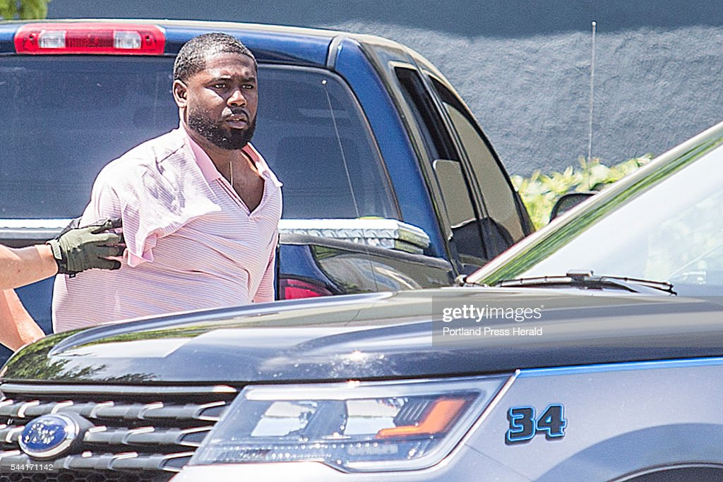 James Jamison, 33, of Waterbury, Connecticut, is taken into custody by police in Scarborough Friday morning, July 1, 2016, after evading police and running into the Fairfield Inn on Cummings Road to hide. Maine authorities say Jamison was smuggling $450,000 worth of heroin to Aroostook County.