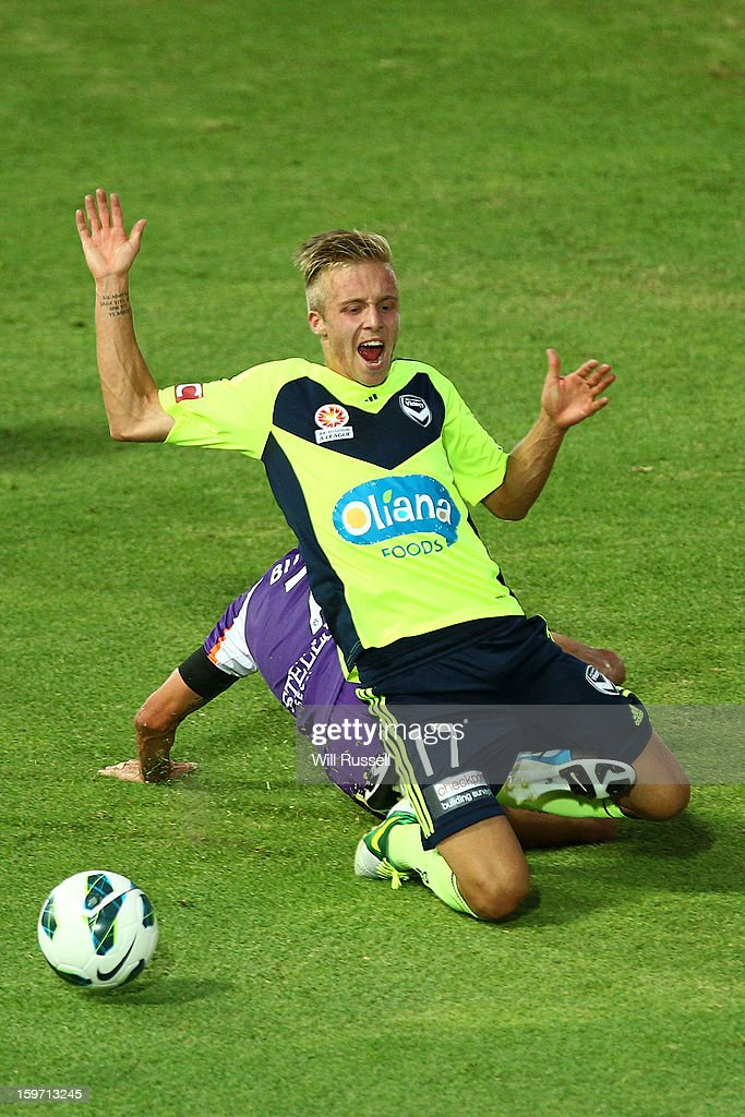 James Jeggo of the Victory is brought down by Jacob Burns of the Glory during the round 17 A-League match between the Perth Glory and the Melbourne Victory at nib Stadium on January 19, 2013 in Perth, Australia.