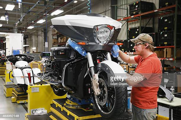James Jenkins helps to build a 2015 Victory Cross Country Tour motorcycle on the assembly line at the Polaris Industries factory on August 8 2014 in...