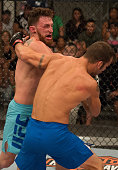 James Jenkins punches Brennan Sevin during the elimination fights at the UFC TUF Gym on July 17 2015 in Las Vegas Nevada