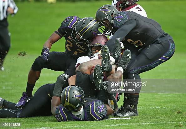 James Johannesson of the Minnesota Golden Gophers is dropped by Traveon Henry Matthew Harris and Anthony Walker of the Northwestern Wildcats at Ryan...