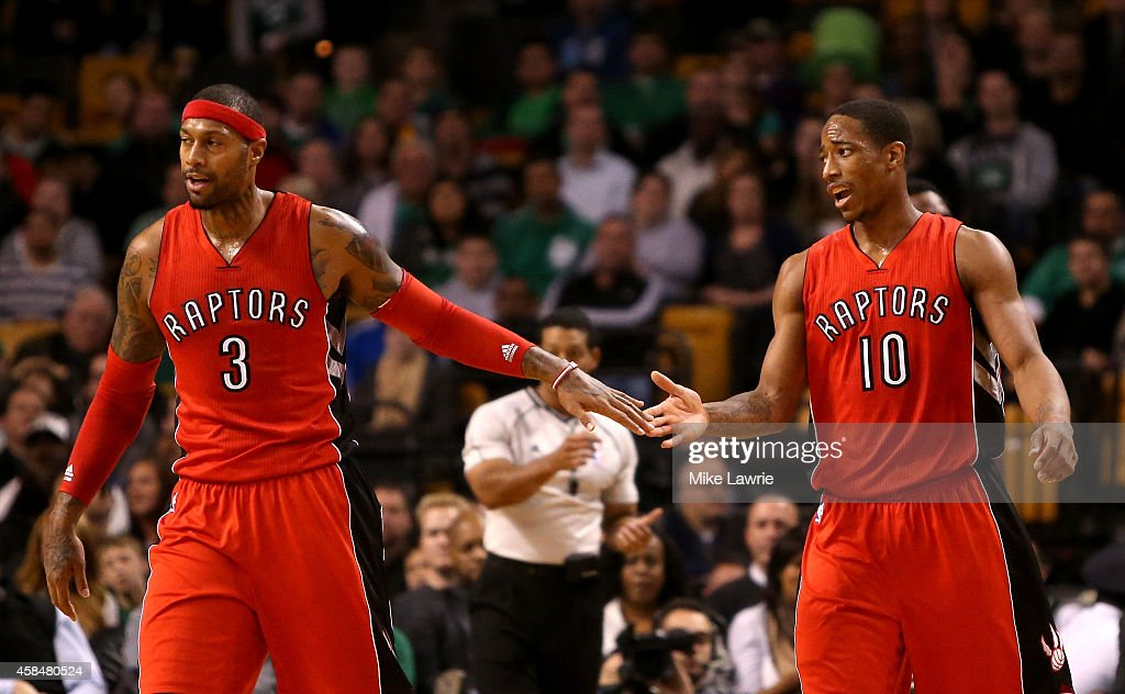 James Johnson #3 and DeMar DeRozan #10 of the Toronto Raptors react after a play in the second half at TD Garden on November 5, 2014 in Boston, Massachusetts.