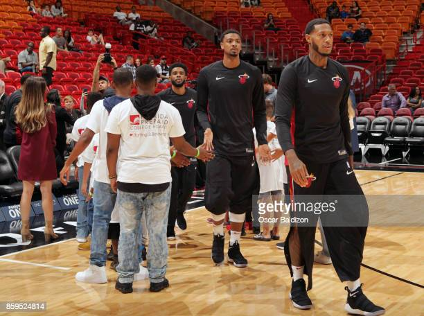 James Johnson and Jordan Mickey of the Miami Heat get introduced before the preseason game against the Charlotte Hornets on October 9 2017 at...