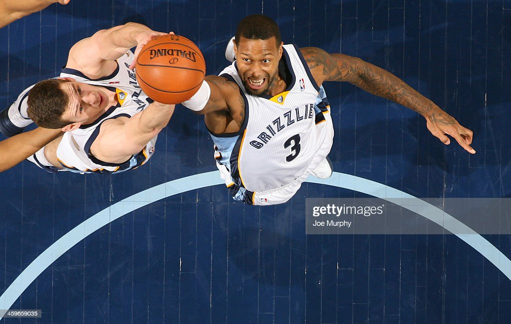 James Johnson #3 of the Memphis Grizzlies rebounds against the Denver Nuggets on December 28, 2013 at FedExForum in Memphis, Tennessee.