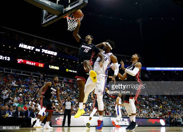 James Johnson of the Miami Heat battles Joel Embiid of the Philadelphia 76ers for a rebound during the game at Sprint Center on October 13 2017 in...