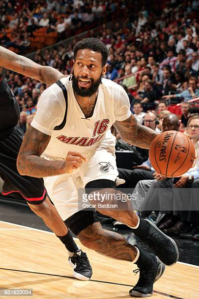 James Johnson of the Miami Heat drives to the basket during the game against the Houston Rockets on January 17 2017 at AmericanAirlines Arena in...