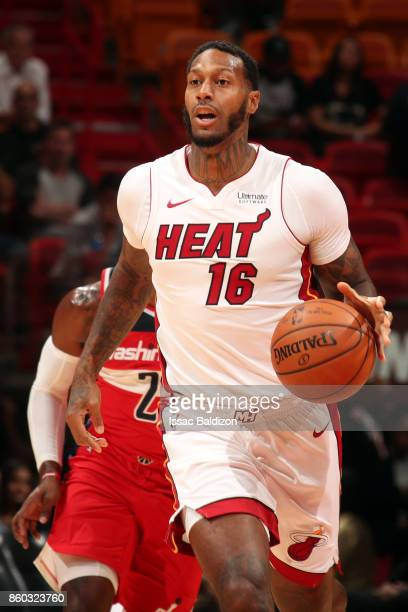 James Johnson of the Miami Heat handles the ball during a preseason game against the Washington Wizards at the American Airlines Arena on October 11...
