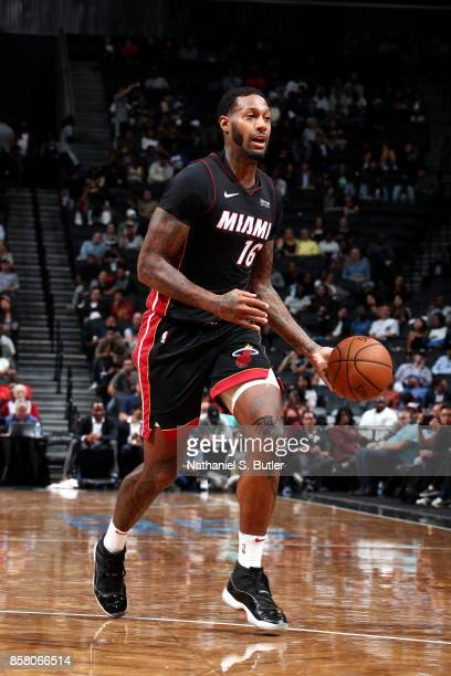 James Johnson of the Miami Heat handles the ball during the game against the Brooklyn Nets during a preseason game on October 5 2017 at Barclays...
