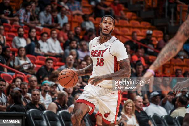 James Johnson of the Miami Heat handles the ball during the preseason game against the Charlotte Hornets on October 9 2017 at AmericanAirlines Arena...
