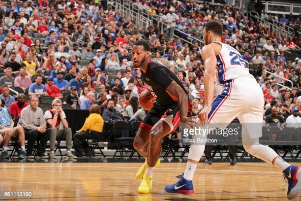 James Johnson of the Miami Heat handles the ball during the preseason game against the Philadelphia 76ers on October 13 2017 at Sprint Center in...