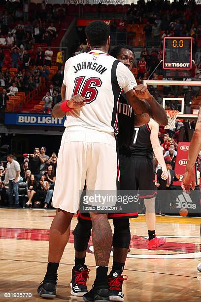 James Johnson of the Miami Heat shares a hug with Patrick Beverley of the Houston Rockets after the game on January 17 2017 at AmericanAirlines Arena...