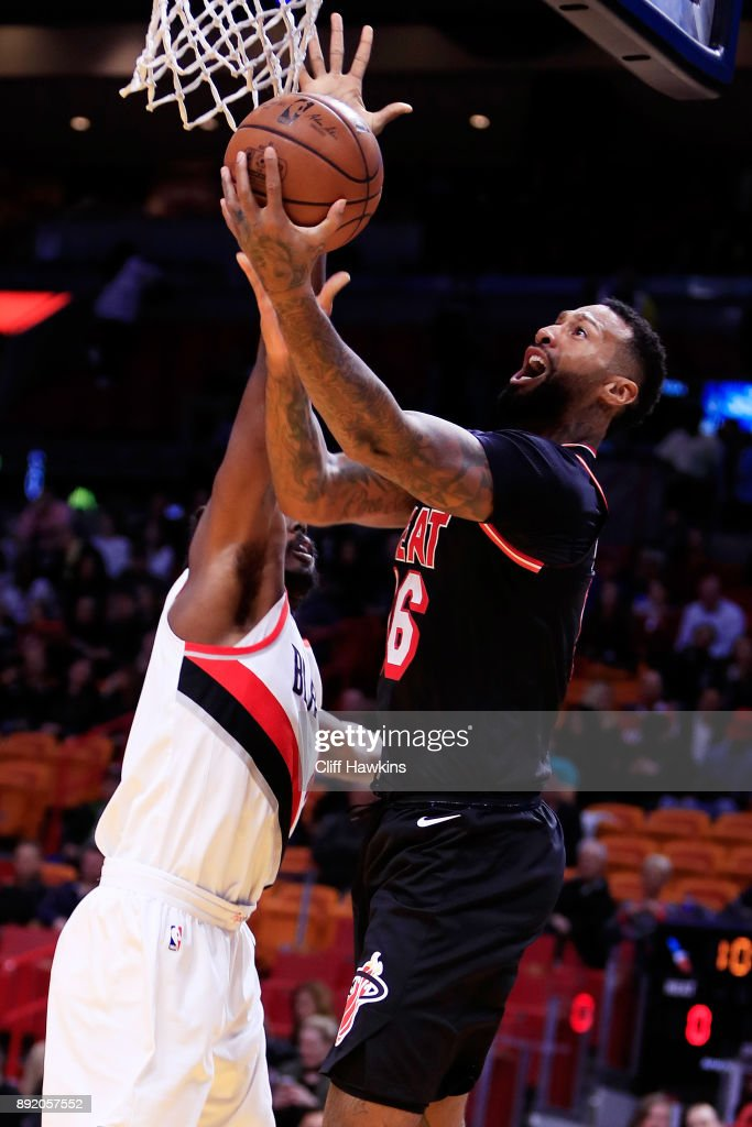 James Johnson #16 of the Miami Heat shoots against Wade Baldwin IV #2 of the Portland Trail Blazers in the first quarter at American Airlines Arena on December 13, 2017 in Miami, Florida.