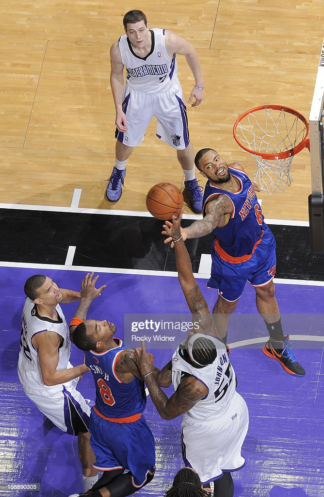 James Johnson #52 of the Sacramento Kings and <a gi-track='captionPersonalityLinkClicked' href=/galleries/search?phrase=Tyson+Chandler&family=editorial&specificpeople=202061 ng-click='$event.stopPropagation()'>Tyson Chandler</a> #6 of the New York Knicks go after the rebound on December 28, 2012 at Sleep Train Arena in Sacramento, California.