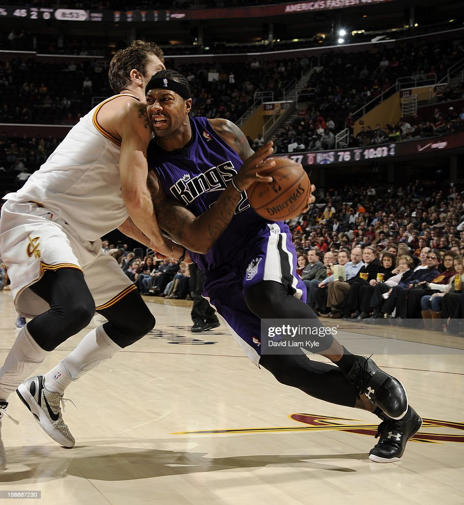 James Johnson #52 of the Sacramento Kings drives to the basket against <a gi-track='captionPersonalityLinkClicked' href=/galleries/search?phrase=Luke+Walton+-+Basketball+Player&family=editorial&specificpeople=202565 ng-click='$event.stopPropagation()'>Luke Walton</a> #4 of the Cleveland Cavaliers at The Quicken Loans Arena on January 2, 2013 in Cleveland, Ohio.