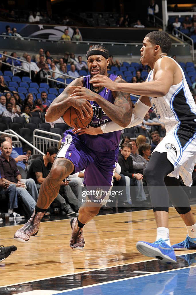James Johnson #52 of the Sacramento Kings drives to the basket against <a gi-track='captionPersonalityLinkClicked' href=/galleries/search?phrase=Tobias+Harris&family=editorial&specificpeople=6902922 ng-click='$event.stopPropagation()'>Tobias Harris</a> #12 of the Orlando Magic on February 27, 2013 at Amway Center in Orlando, Florida.