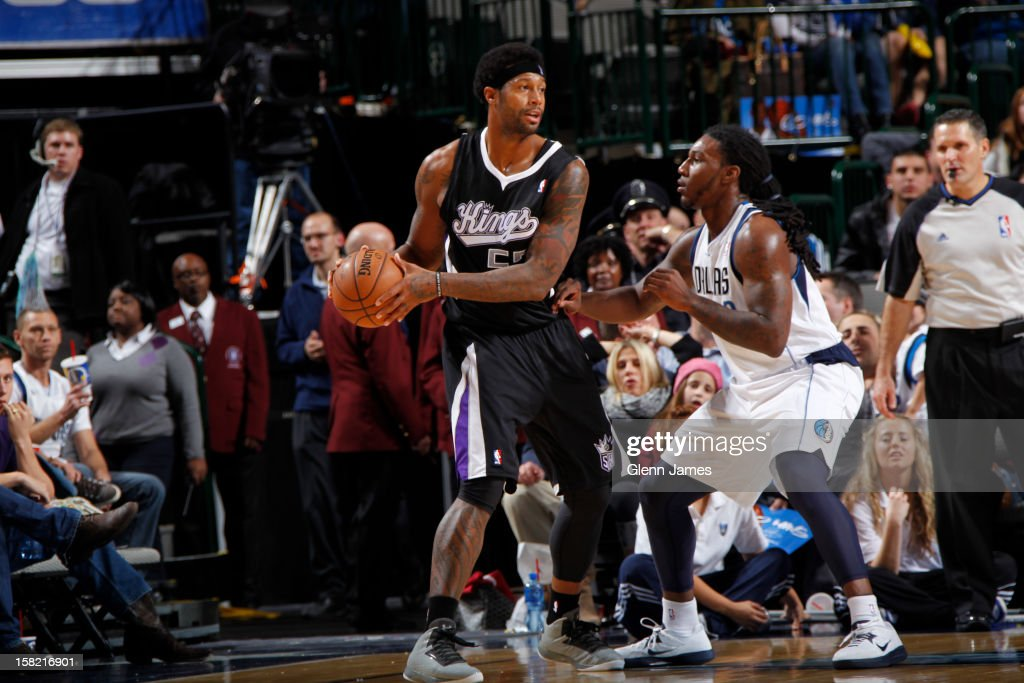 James Johnson #52 of the Sacramento Kings looks to pass the ball against <a gi-track='captionPersonalityLinkClicked' href=/galleries/search?phrase=Jae+Crowder&family=editorial&specificpeople=7357507 ng-click='$event.stopPropagation()'>Jae Crowder</a> #9 of the Dallas Mavericks on December 10, 2012 at the American Airlines Center in Dallas, Texas.