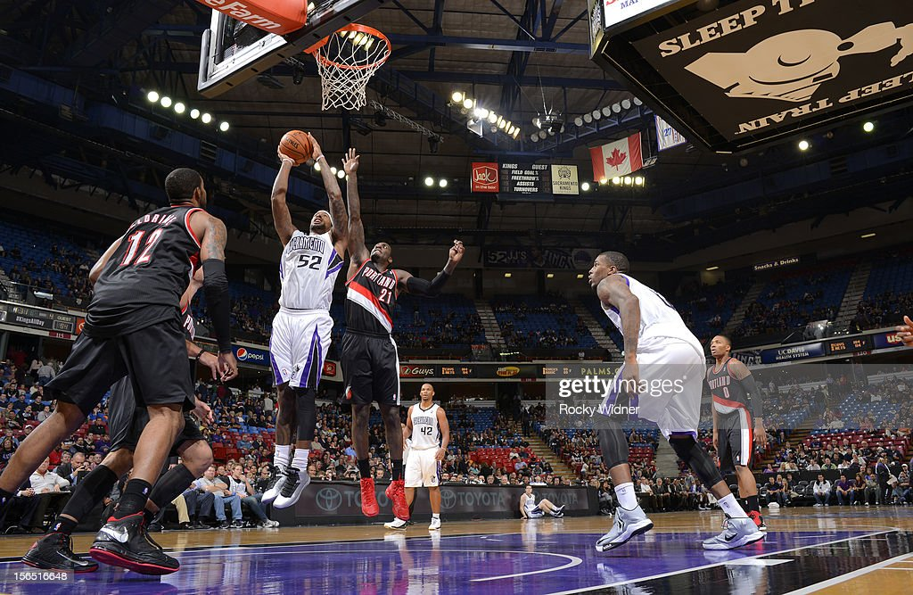 James Johnson #52 of the Sacramento Kings puts up a shot against <a gi-track='captionPersonalityLinkClicked' href=/galleries/search?phrase=J.J.+Hickson&family=editorial&specificpeople=4226173 ng-click='$event.stopPropagation()'>J.J. Hickson</a> #21 of the Portland Trail Blazers on November 13, 2012 at Sleep Train Arena in Sacramento, California.