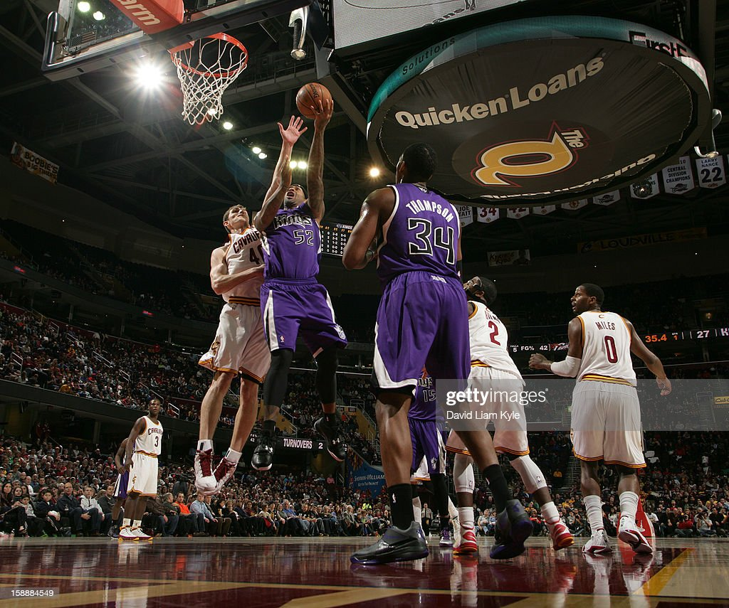 James Johnson #52 of the Sacramento Kings shoots a layup against Tyler Zeller #40 of the Cleveland Cavaliers at The Quicken Loans Arena on January 2, 2013 in Cleveland, Ohio.