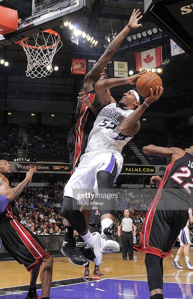 James Johnson #52 of the Sacramento Kings shoots against Joel Anthony #50 of the Miami Heat on January 12, 2013 at Sleep Train Arena in Sacramento, California.