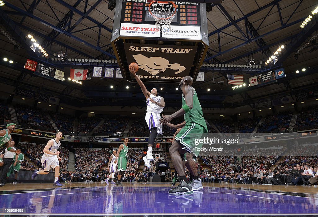 James Johnson #52 of the Sacramento Kings shoots against Kevin Garnett #5 of the Boston Celtics on December 30, 2012 at Sleep Train Arena in Sacramento, California.