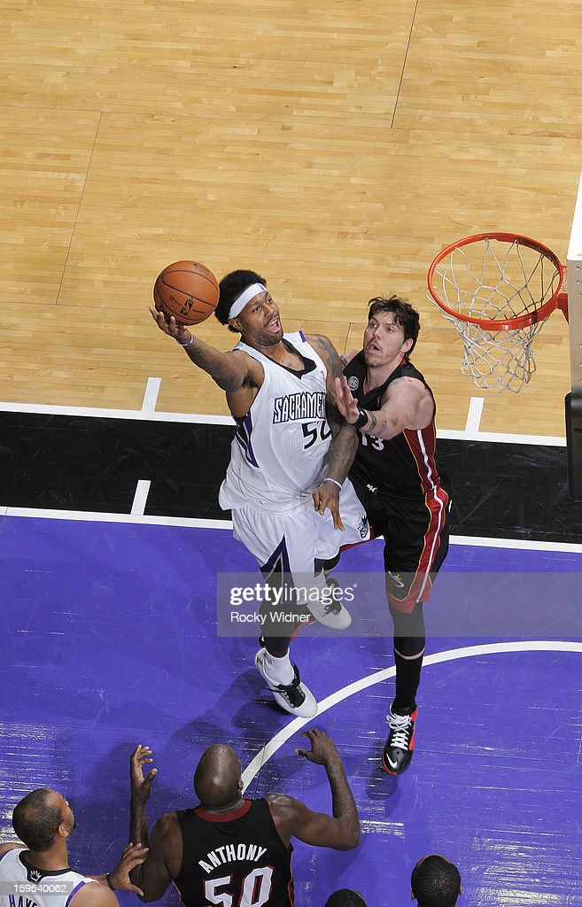 James Johnson #52 of the Sacramento Kings shoots against <a gi-track='captionPersonalityLinkClicked' href=/galleries/search?phrase=Mike+Miller+-+Basketball+Player&family=editorial&specificpeople=201801 ng-click='$event.stopPropagation()'>Mike Miller</a> #13 of the Miami Heat on January 12, 2013 at Sleep Train Arena in Sacramento, California.