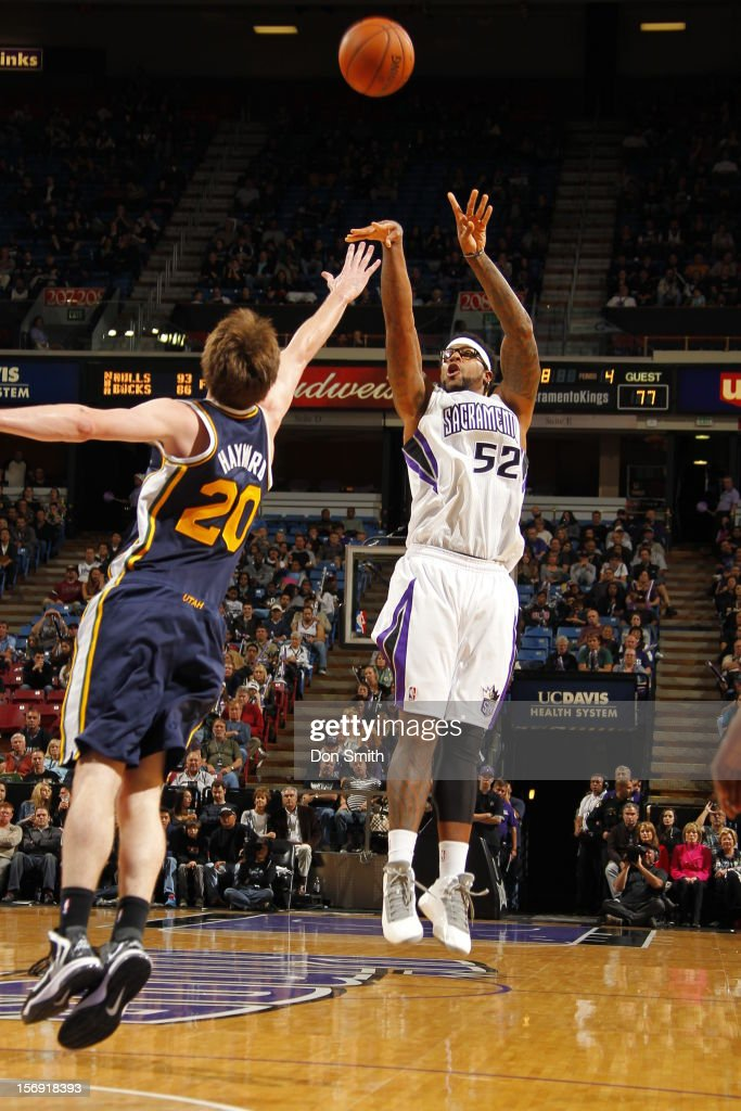 James Johnson #52 of the Sacramento Kings shoots the ball against Gordon Hayward #20 of the Utah Jazz on November 24, 2012 at Sleep Train Arena in Sacramento, California.