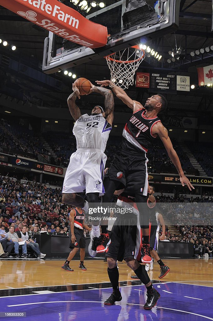 James Johnson #52 of the Sacramento Kings takes the ball to the basket against Jared Jeffries #1 of the Portland Trail Blazers on November 13, 2012 at Sleep Train Arena in Sacramento, California.