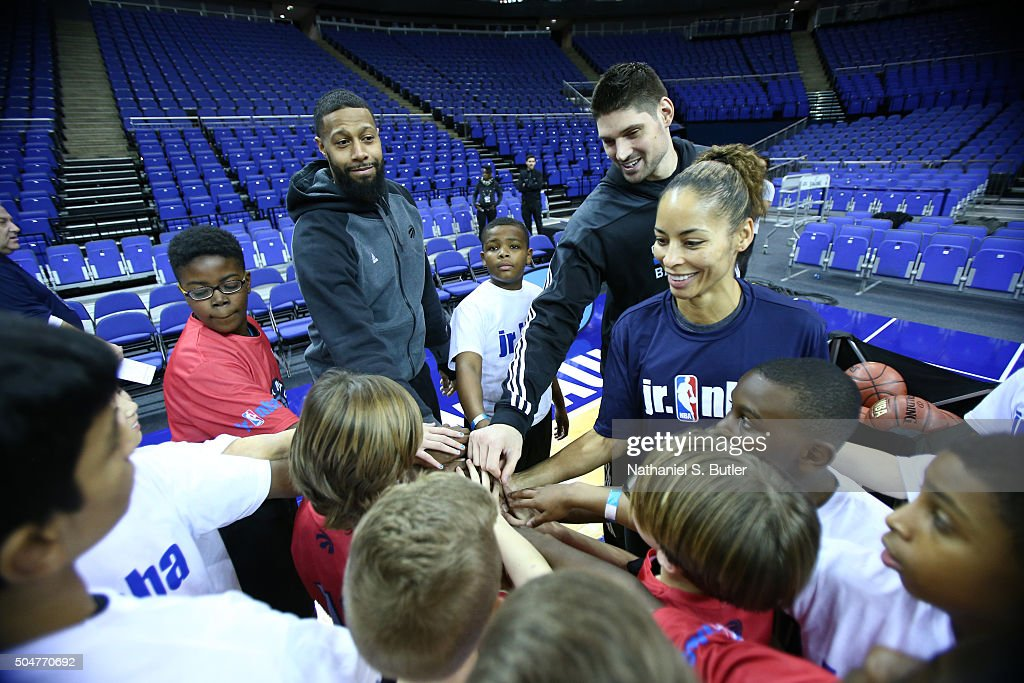 James Johnson of the Toronto Raptors and Nikola Vucevic of the Orlando Magic and WNBA Legend Allison Feater huddles up with the kids during the Jr. NBA clinic as part of the 2016 Global Games London on January 13, 2016 at The O2 Arena in London, England.