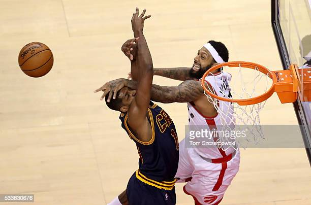 James Johnson of the Toronto Raptors and Tristan Thompson of the Cleveland Cavaliers go for a rebound in the first half in game four of the Eastern...