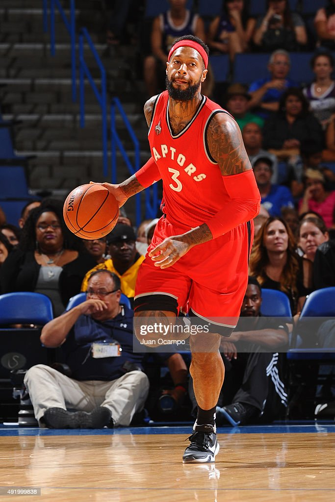 <a gi-track='captionPersonalityLinkClicked' href=/galleries/search?phrase=James+Johnson+-+Basketball&family=editorial&specificpeople=7670910 ng-click='$event.stopPropagation()'>James Johnson</a> #3 of the Toronto Raptors dribbles the ball against the Los Angeles Lakers during a preseason game on October 08, 2015 at Citizens Bank Arena in Ontario, California.