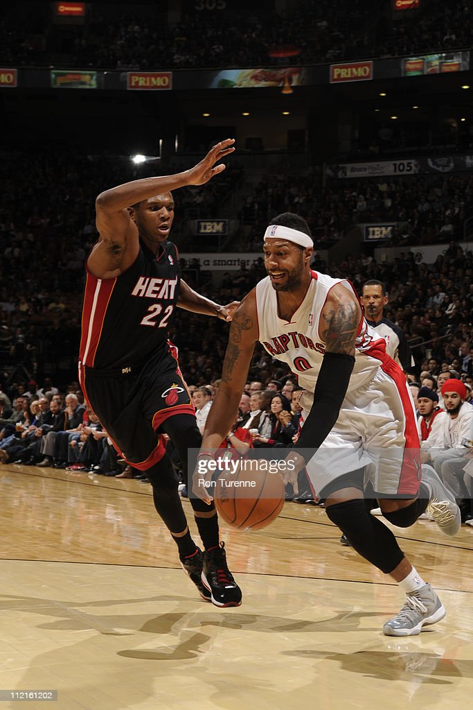 James Johnson #0 of the Toronto Raptors drives against James Jones #22 of the Miami Heat during a game on April 13, 2011 at the Air Canada Centre in Toronto, Ontario, Canada.