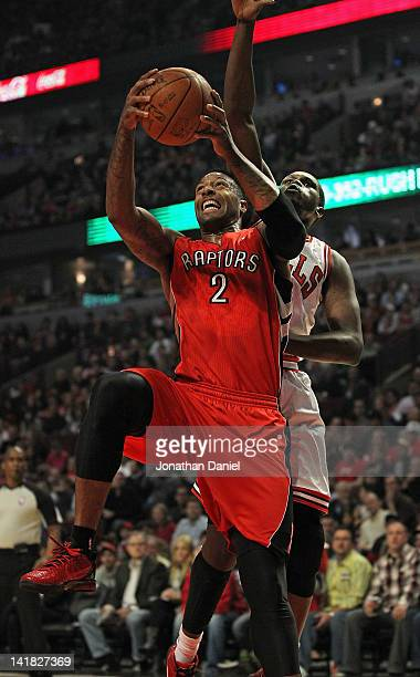 James Johnson of the Toronto Raptors drives to the basket against Loul Deng of the Chicago Bulls at the United Center on March 24 2012 in Chicago...