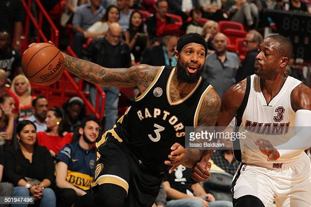 James Johnson of the Toronto Raptors drives to the basket against Dwyane Wade of the Miami Heat on December 18 2015 at AmericanAirlines Arena in...
