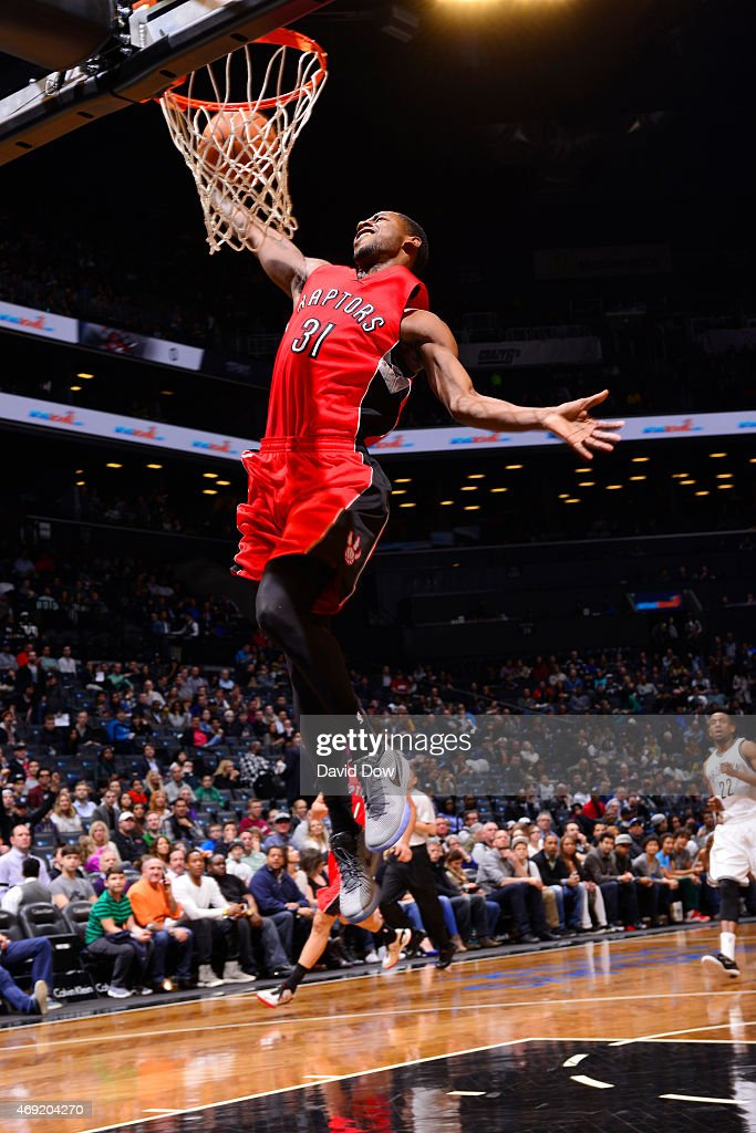 James Johnson #3 of the Toronto Raptors dunks the ball against the Brooklyn Nets at Barclays Center on April 3, 2015 in Brooklyn, New York