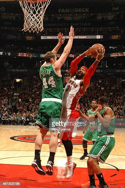 James Johnson of the Toronto Raptors goes to the basket against Tyler Zeller of the Boston Celtics on January 10 2015 at the Air Canada Centre in...