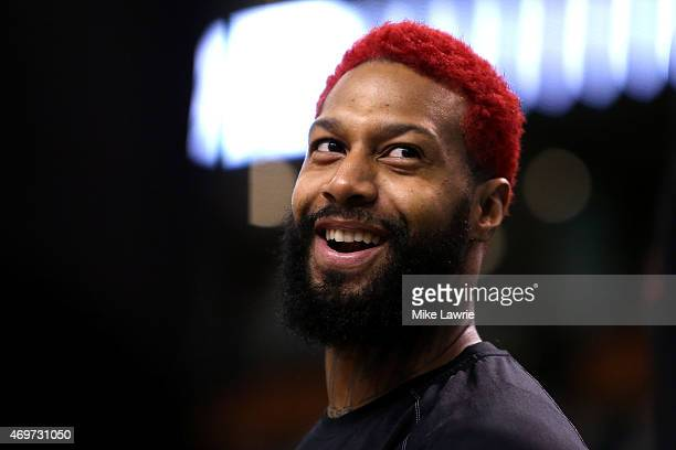 James Johnson of the Toronto Raptors looks on during warm ups before the game against the Boston Celtics at TD Garden on April 14 2015 in Boston...