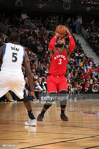 James Johnson of the Toronto Raptors shoots against Gorgui Dieng of the Minnesota Timberwolves at Canadian Tire Centre on October 14 2015 in Ottawa...