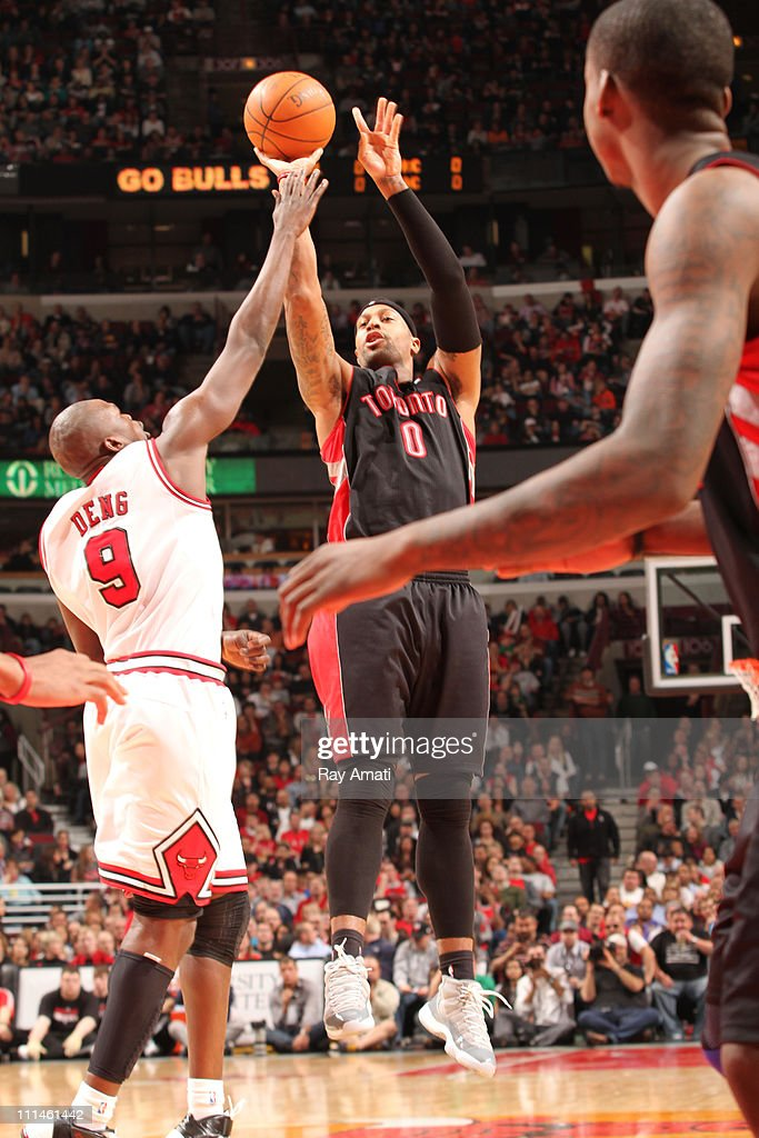 James Johnson #0 of the Toronto Raptors shoots against <a gi-track='captionPersonalityLinkClicked' href=/galleries/search?phrase=Luol+Deng&family=editorial&specificpeople=202830 ng-click='$event.stopPropagation()'>Luol Deng</a> #9 of the Chicago Bulls on April 2, 2011 at the United Center in Chicago, Illinois.