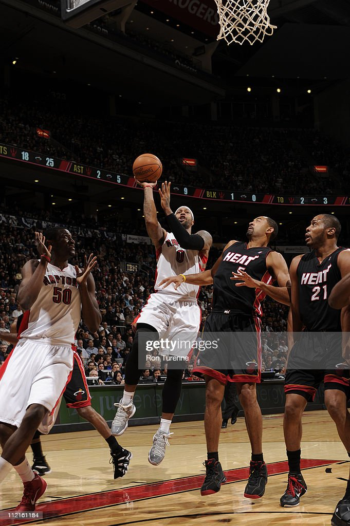 James Johnson #0 of the Toronto Raptors shoots over <a gi-track='captionPersonalityLinkClicked' href=/galleries/search?phrase=Juwan+Howard&family=editorial&specificpeople=201642 ng-click='$event.stopPropagation()'>Juwan Howard</a> #5 of the Miami Heat during a game on April 13, 2011 at the Air Canada Centre in Toronto, Ontario, Canada.