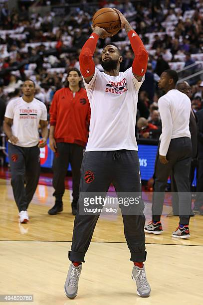 James Johnson of the Toronto Raptors warms up prior to the NBA season opener against the Indiana Pacers at Air Canada Centre on October 28 2015 in...