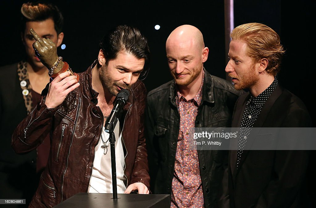 James Johnson, Simon Neil and Ben Johnson of Biffy Clyro collect the award for Best British Band at the NME Awards 2013 at the Troxy on February 27, 2013 in London, England.
