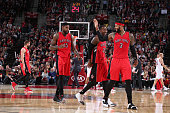 James Johnson Terrence Ross and Amir Johnson of the Toronto Raptors celebrate during the game against the Portland Trail Blazers on December 30 2014...