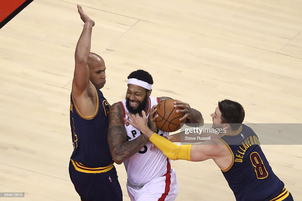 James Johnson tries to get between Richard Jefferson and Matthew Dellavedova as the Toronto Raptors beat the Cleveland Cavaliers in game 4 of the NBA Conference Finals in Toronto. May 23, 2016.