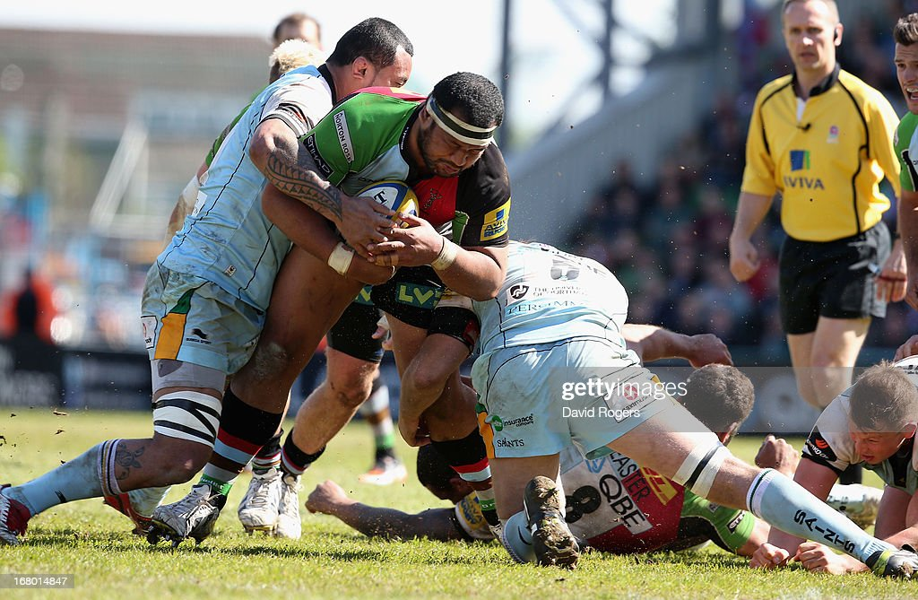 James Johnston of Harlequins is tackled during the Aviva Premiership match between Harlequins and Northampton Saints at Twickenham Stoop on May 4, 2013 in London, England.