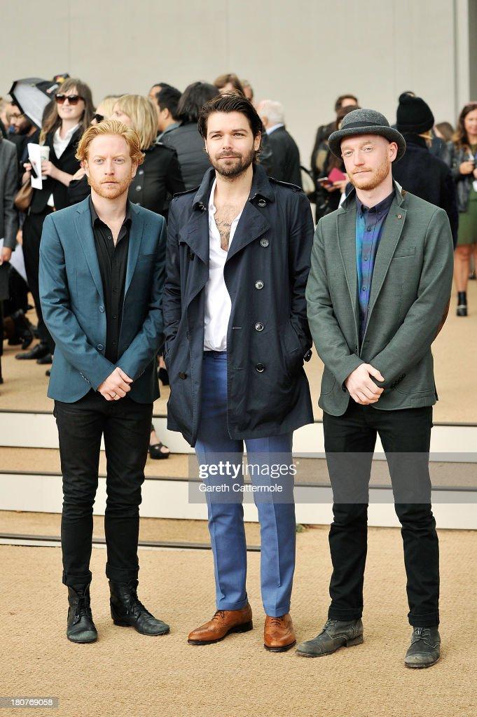 James Johnston, Simon Neil and Ben Johnston arrive at Burberry Prorsum Womenswear Spring/Summer 2014 show during London Fashion Week at Kensington Gardens on September 16, 2013 in London, England.