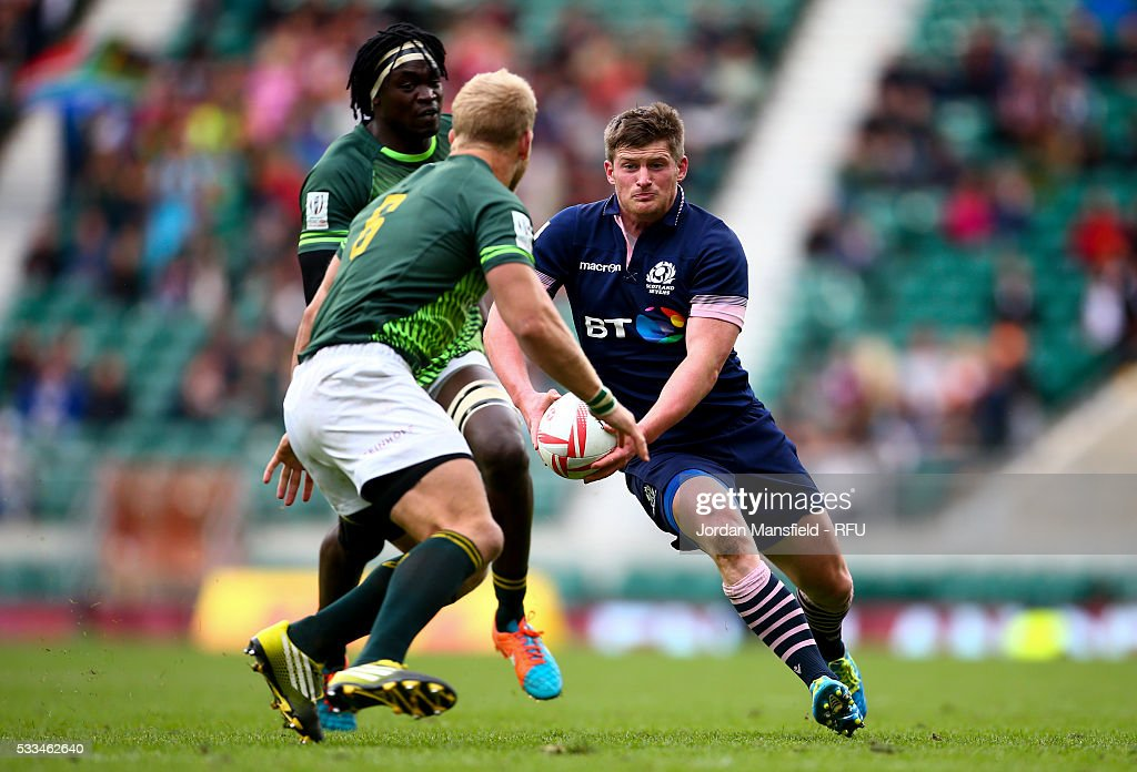 James Johnstone of Scotland avoids a tackle from <a gi-track='captionPersonalityLinkClicked' href=/galleries/search?phrase=Kyle+Brown+-+Rugby+Player&family=editorial&specificpeople=5870383 ng-click='$event.stopPropagation()'>Kyle Brown</a> of South Africa during day two of the HSBC London Sevens at Twickenham Stadium on May 22, 2016 in London, United Kingdom.