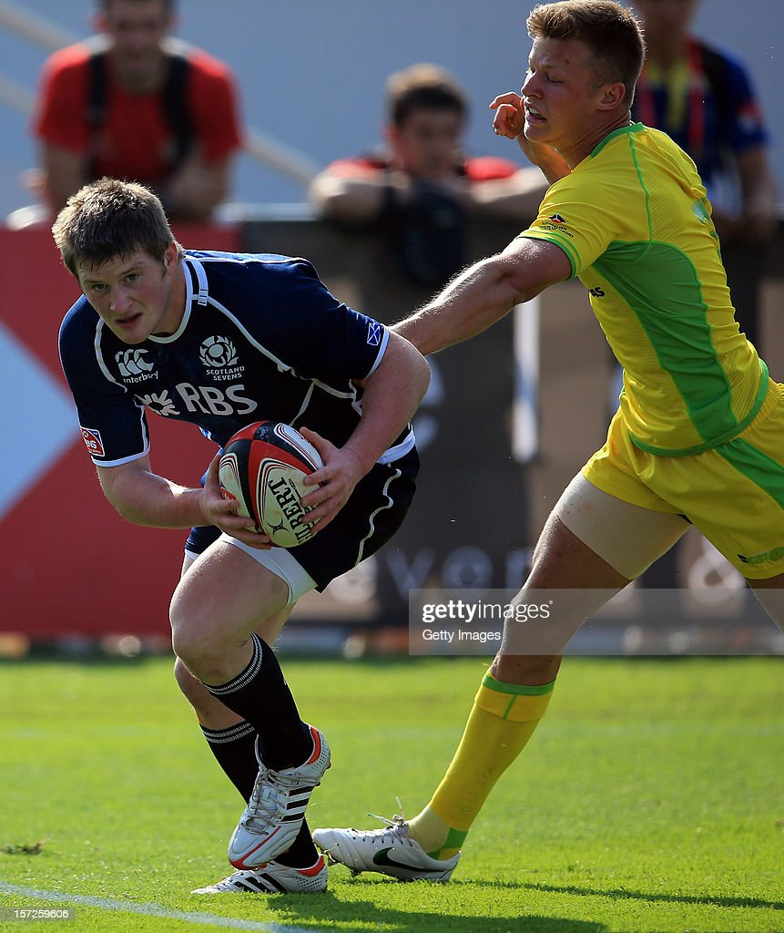 James Johnstone of Scotland beats Cameron Clark of Australia to score the Dubai Bowl Quarter Final match during the Emirates IRB Dubai Sevens, Round 2 of the HSBC Sevens World Series on December 1, 2012 in Dubai, United Arab Emirates.