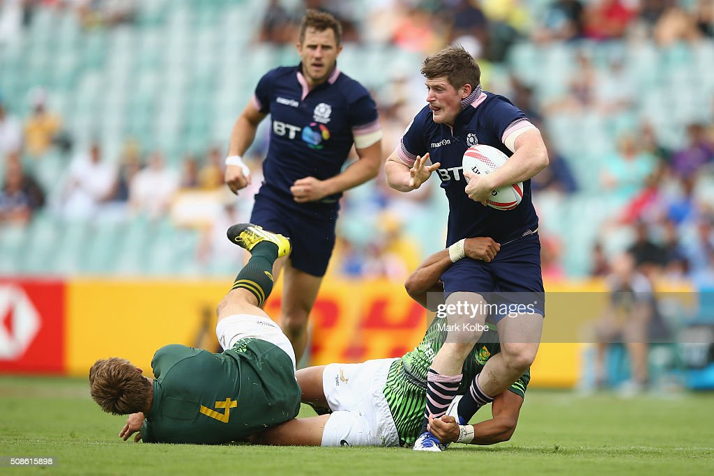 James Johnstone of Scotland is tackled during the 2016 Sydney Sevens match between South Africa and Scotland at Allianz Stadium on February 6, 2016 in Sydney, Australia.