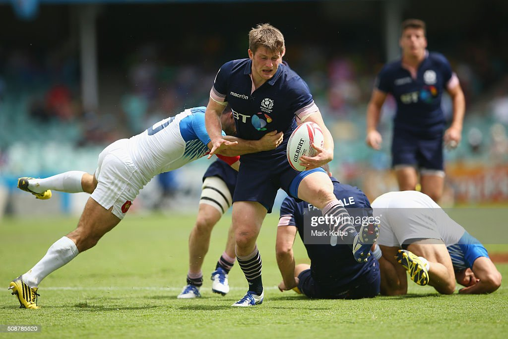 James Johnstone of Scotland is tackled during the 2016 Sydney Sevens bowl quarter final match between Scotland and France at Allianz Stadium on February 7, 2016 in Sydney, Australia.